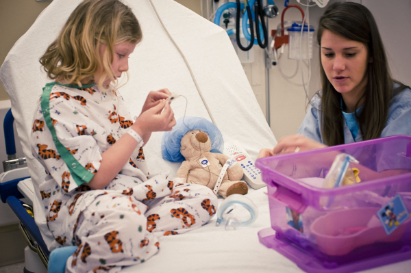 Girl playing with teddy bear - patient experience