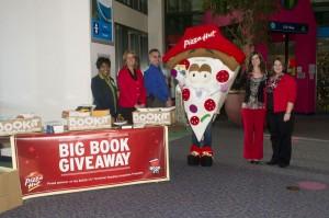 Pizza Hut donates 500 books to Akron Children's