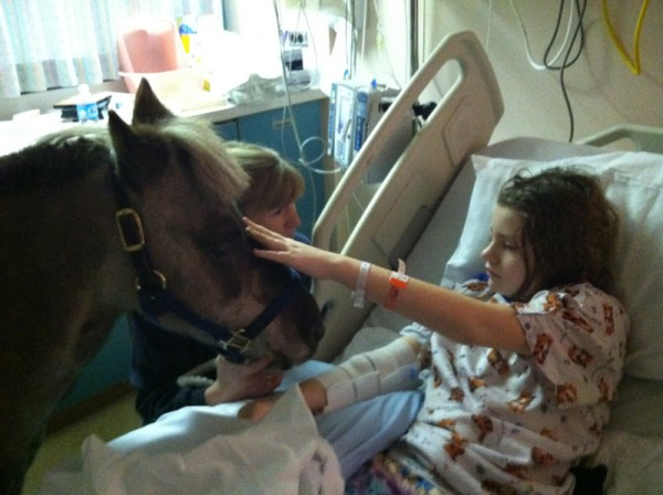 Emily Selders enjoys a visit from Petie the Pony