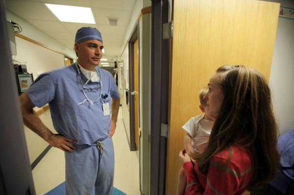 Dr. Milo talks to Pollocks before surgery
