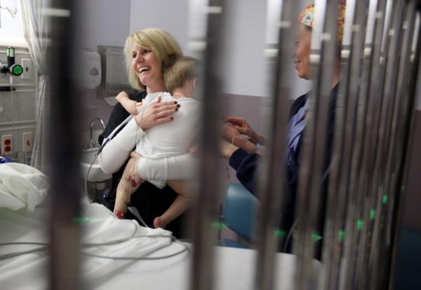 PACU nurse Holly Bauer holds Jordan