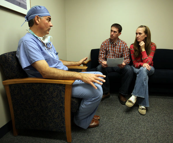 After surgery, Dr. Milo lets Megs and Randy know that everything went well.