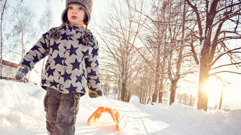 boy-pulling-sled