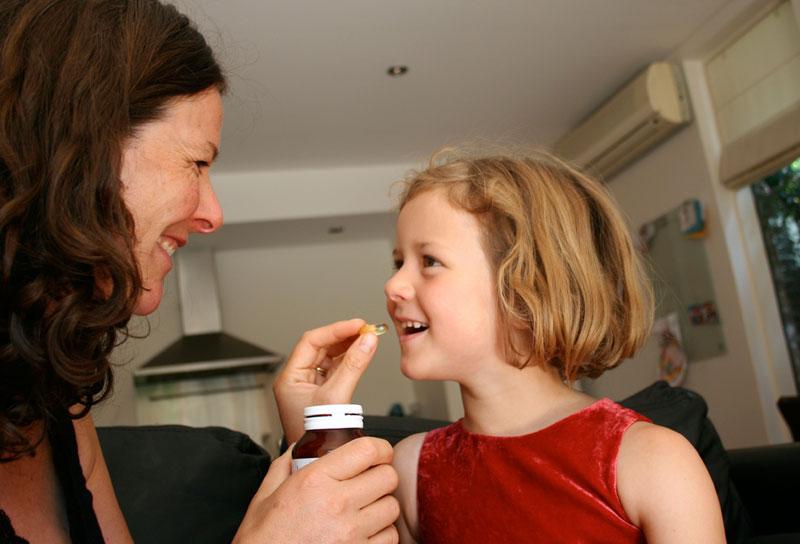 girl-daughter-mom-medicine-vitamin-pill