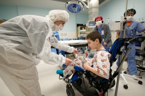 Child life specialist with boy in OR
