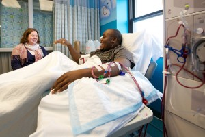 Music therapist Sarah Tobias and dialysis patient Chris Blackwell