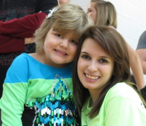 Patient Ava Turner and a Flash-a-Thon student
