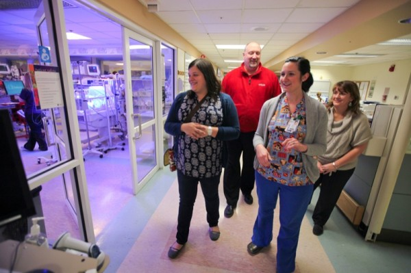 Nurse Kelly Powell and Julie Wright take Megan and Mark Postak on a tour of the neonatal intensive care unit.