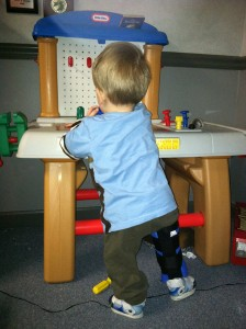 Jordan standing and playing at workshop