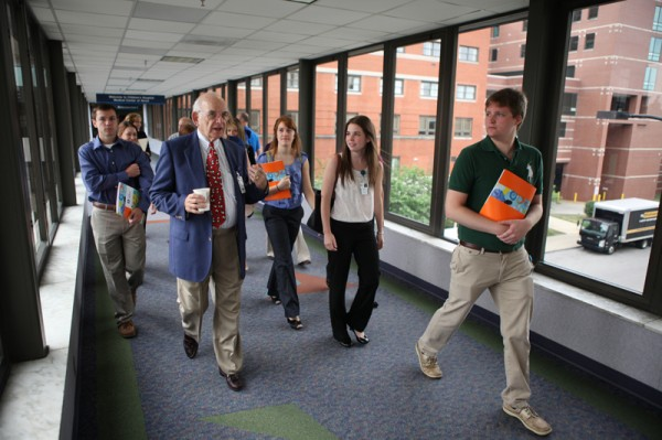 Dr. Stone (left) walks with a group of Summer Pediatric Research Scholars. The students – college sophomores or juniors who are interested in careers in medical-related fields – conduct research projects mentored by doctors, surgeons, clinical pharmacologists and others.