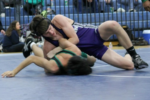 Chris competes in a wrestling match.