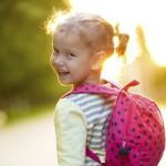 child-backback-smiling