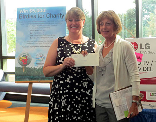 Janis Worley, left, won the grand prize for her closest birdie guess.