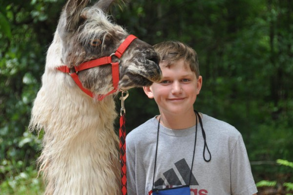 Daniel is pictured in June at Cub Creek Animal Science Camp (Rolla, MO), where he spent a week learning about and caring for animals in a junior vet program.