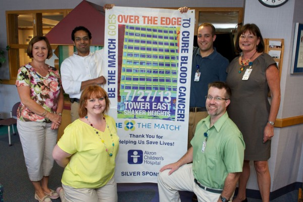 (L to R) Sue Neitz, BSN, CNP, CPON Stem Cell Transplant Program Coordinator, Prasad Bodas, MD  Hematology/Oncology Attending Physician, Matthew Tweddle, Hematology/Oncology Chaplain, Jackie Luzader, BSN,CCRC, NMDP Coordinato, (kneeling) Tonya Davis, Account executive-recruitment -Be The Match and Paul Moser, Hematology/Oncology Pharmacist