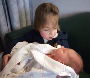 Bekah holds her new brother, Sam