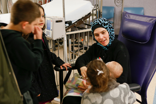 Family reunion: The Mustafa family visits with Noor after her cleft lip surgery.