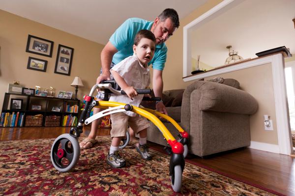 Brent helps Lucas with his walker