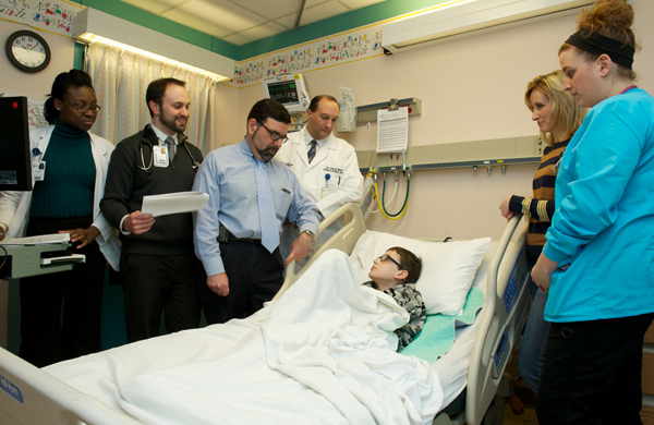 Family-centered rounds include the active participation of the patient and family during bedside discussions among clinicians.
