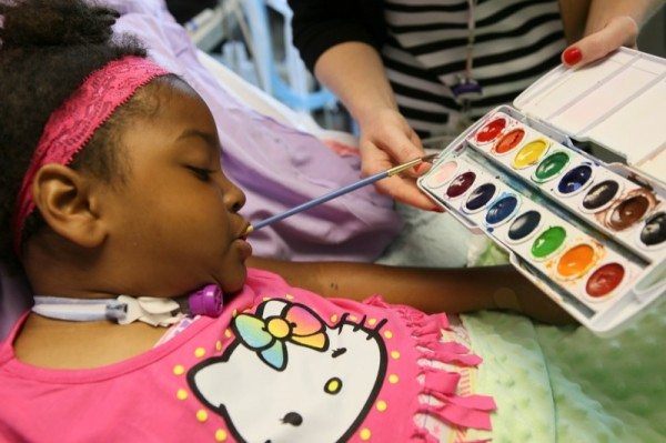 Paralyzed 6 year old uses her mouth to create art
