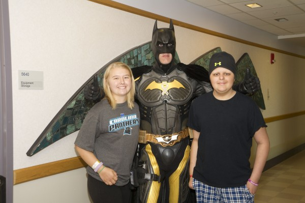 Jackie and Luke pose with Batman. Jackie donated 10 inches of her hair to Locks of Love just before the picture was taken.