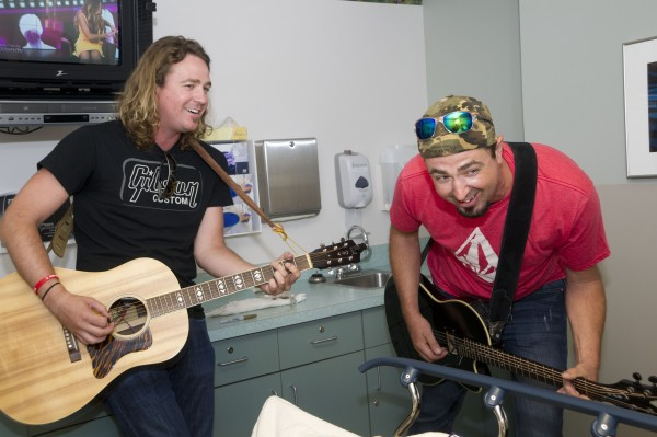 Brother Trouble, a country music duo, delighted patients throughout the hospital with their music.