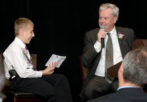 Bill Considine, president and CEO of Akron Children's Hospital and Anthony Solari, a change bandit and former patient, co-host the Akron Champion's for Children's event, which was held on May 22.