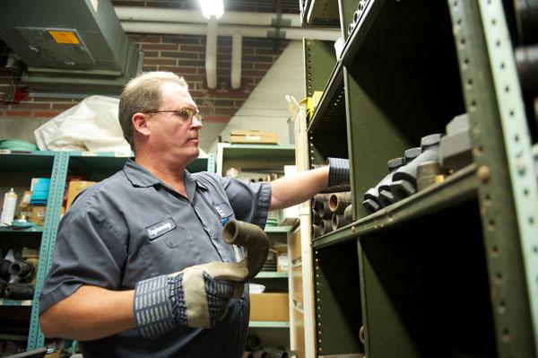Hirsch organizes plumbing supplies before starting a job.