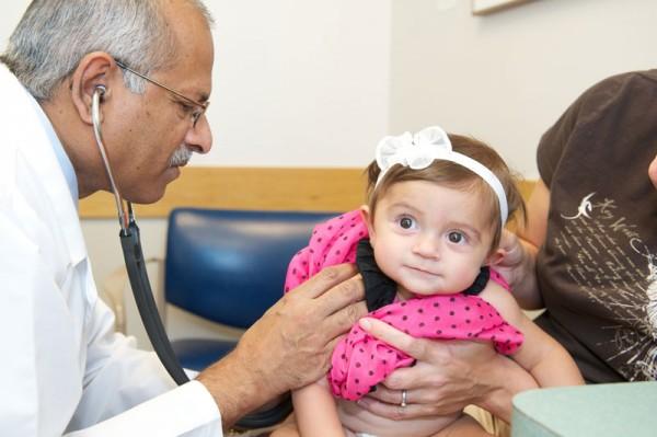 Dr. Chandrakant Patel examines Saige.