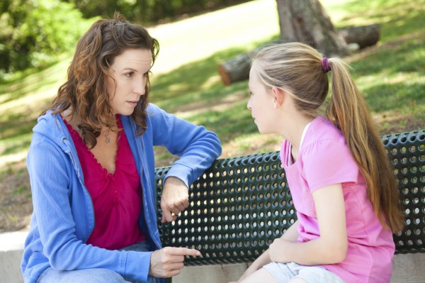 concerned mother talking to daughter