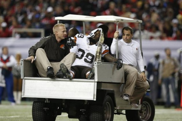 Tashaun Gipson is carted off the field after his knee injury.