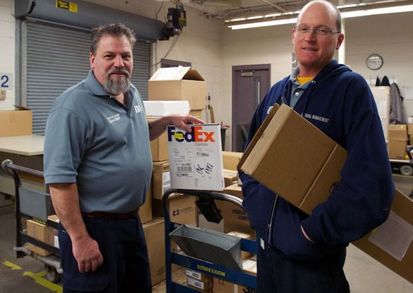 Storeroom clerks Gene Talbot and Todd Winzinek are part of a 5-man team that handles about 2,500 deliveries every month.