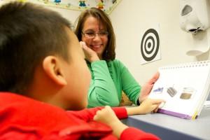 Liz Rebadow and Noah in adoptive health center
