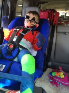 Jordan in car seat with hip spica cast