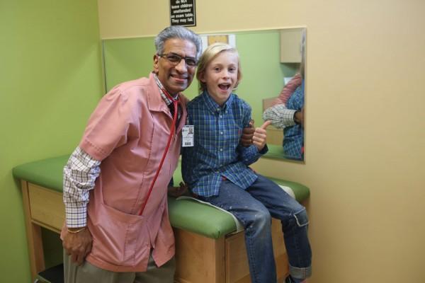 Ethan Hoffman with Dr. Guru at his pediatrician's office in Warren