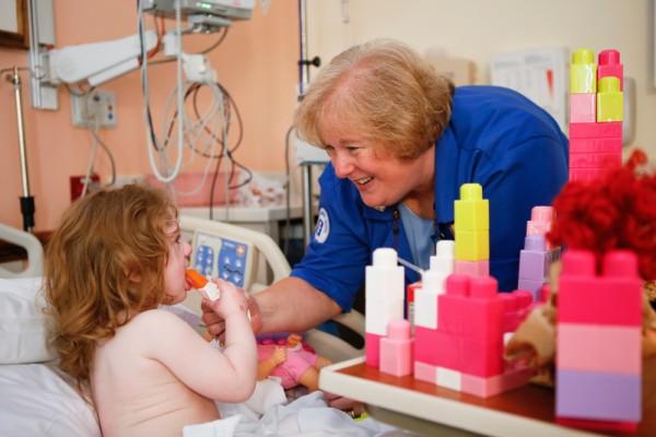 Volunteer Marijo Lendak with a patient.