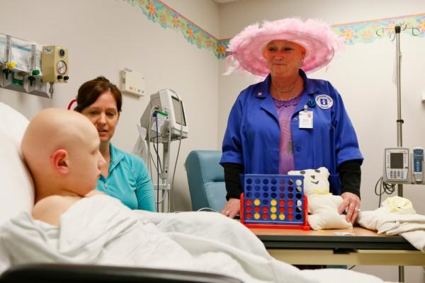Volunteer Monica Zackeroff loves brightening the spirits of a sick child.