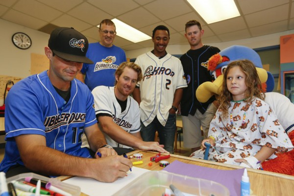 Rubber Ducks catcher Jeremy Lucas surprised 7-year-old Avril with his art skills. He sketched a picture of Ducks mascot Webster and signed it.
