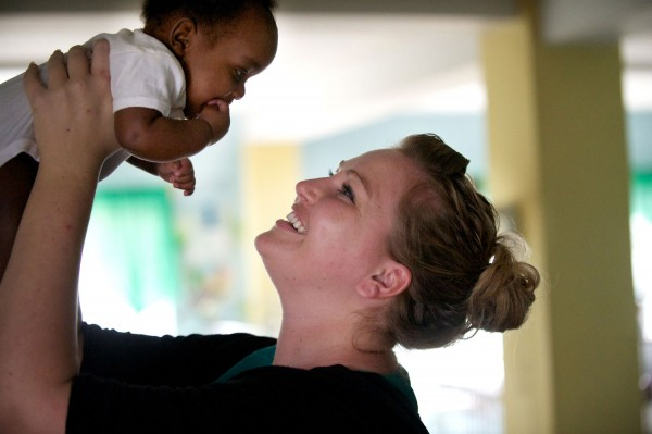 Dr. Brittany Potts holds a malnourished baby who was abandoned at St. Damien's Pediatric Hospital in Haiti (Photo credit: Ted Stevens)