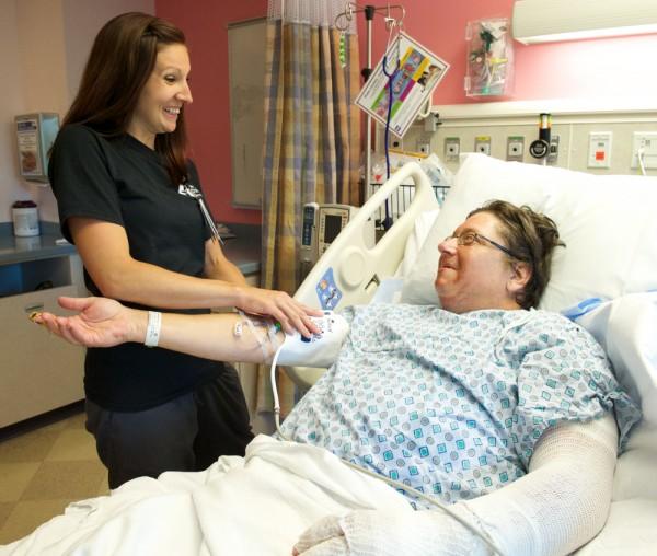 Jamie Lucey talks with patient Greg Workman.