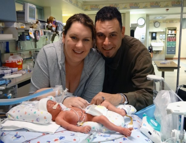 Newborn Simon and his parents during his 82-day stay in the NICU.