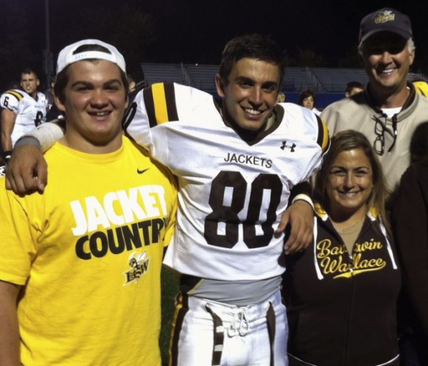 Dr. Adams with husband John and son Ben (left) at Gabe's football game at Baldwin Wallace College.