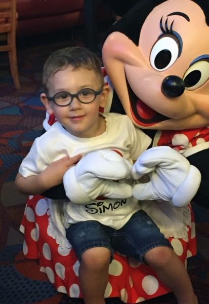 Simon also got to meet Minnie Mouse on his trip to Disney World.