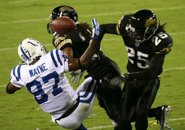 Speed players, such as the wide receiver and defensive backs in this picture, can be prone to high momentum collisions, which can put them at greater risk for neurodegenerative disorders in later life.
