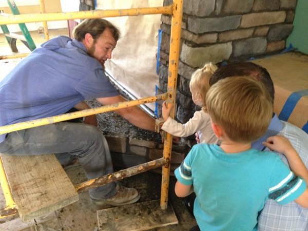 Randy, Jordan and Gabriella talking to construction worker