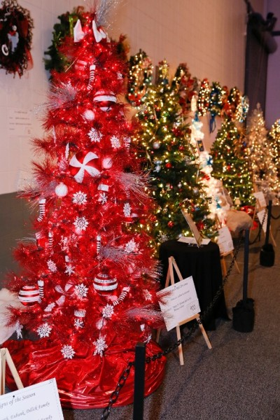 """""""Rosso Natalé,"""" Italian for """"Red Christmas"""" features a radiant red tree with sparkling lights, peppermint swirl bulbs, striped stockings and snowflake accents."""