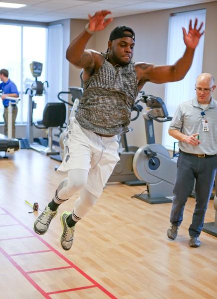 Sports Rehabilitation Team Guides Collegiate Athlete throughout Football Career