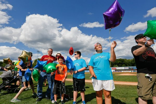 Childhood cancer survivors play ball with Scrappers