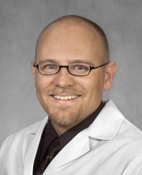 Dr. David Karas