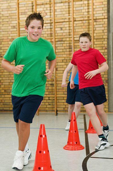Boys running a slalom race